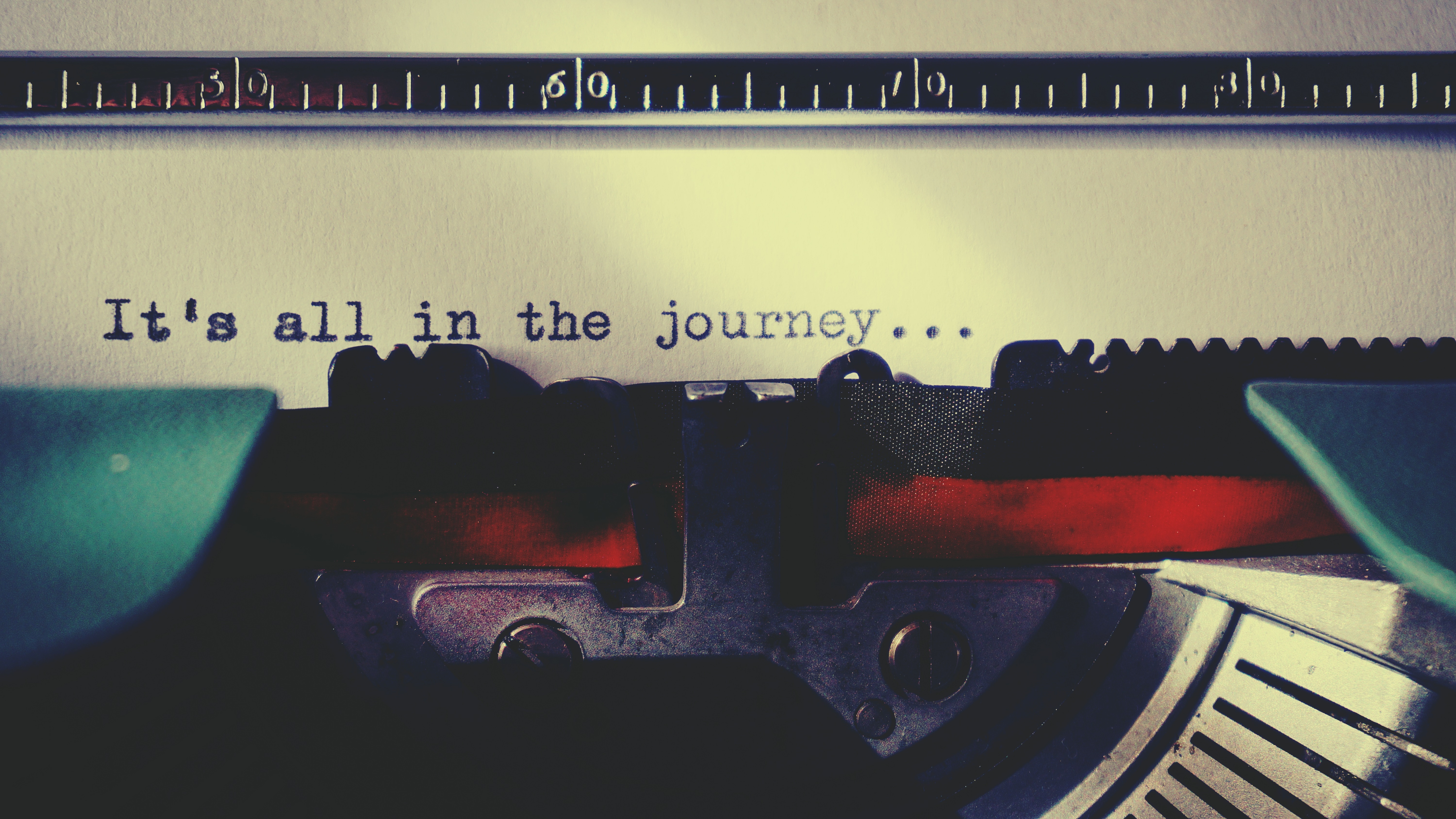 a typewriter typed 'it's all in the journey'