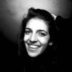 a black and white closeup of a woman smiling